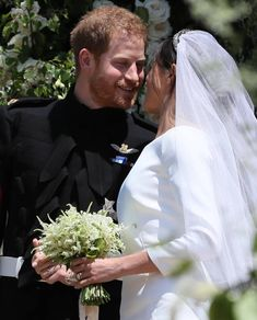 Prince Harry, Duke of Sussex and The Duchess of Sussex kiss as they leave St George's Chapel at Windsor Castle before the wedding of Prince Harry to Meghan Markle on May 2018 in Windsor, England. Get premium, high resolution news photos at Getty Images Royal Wedding Prince Harry, Harry And Meghan Wedding, Harry Wedding, Wedding Day, Wedding Ceremony, Wedding Dress, Wedding Bouquets, Wedding Flowers, Lady Diana