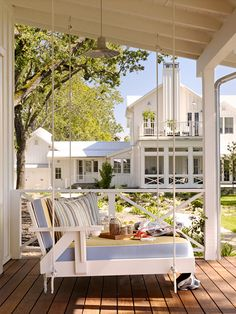 Swing! Front Porch Swing recycled from an old wood chaise lounge. I think this would be my spot on the front porch! Cute!
