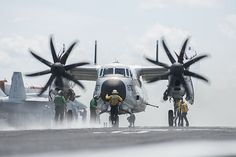 Sailors direct an C-2A Greyhound assigned to the Rawhides of Fleet Logistic Support Squadron (VRC) 40 on the flight deck of the aircraft carrier USS Harry S. Truman (CVN 75).
