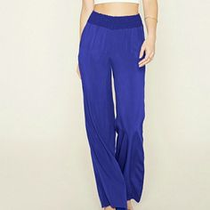 F21 Wide leg pant Festival Season Sale item!  COMMENT FOR 20% OFF Semi sheer woven pants. Front pockets. Smocked waist (will stretch) 100% rayon  Waist 31in Hips 42in Forever 21 Pants