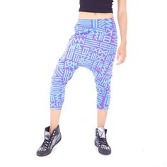 "Unisex drop crotch harem pant.  Loose fit above the knee and tapers at the bottom. Fold over waistband for a low rise or unfold for a high waist look. Bold all-over print ""X-Amount"" inspired by African mudcloth textiles. Designed by AndreasOne for PEACEfits"