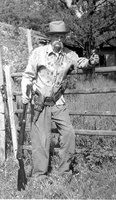Cowboy with a Winchester Model 1886 and a Colt 1873 revolver