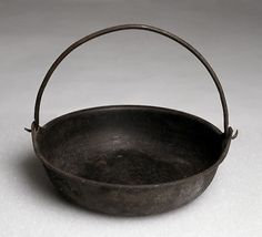 Iron cooking pot, mid-1800s  Women made do with very little on the trail and frontier. Iron pots like this one were valuable commodities. A wife might own only a kettle, frying pan, and coffeepot to prepare meals for her family.  (Museum of the American West, 88.227.2)