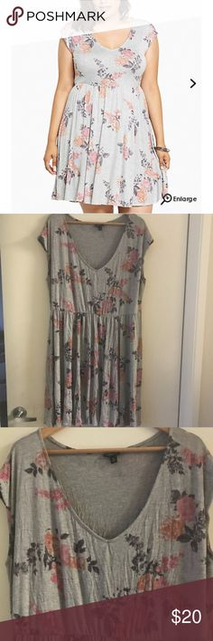 Floral print jersey skater dress Heather grey jersey knit is silky soft and basically the most comfy thing ever when paired with an elastic waist. The faded floral print is vintage-inspired while the v-neck is for the modern girl. torrid Dresses