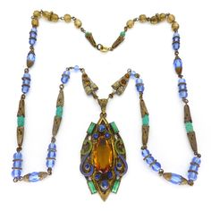 Description A beautiful Czech Art Deco necklace featuring a beautiful enamelled pendant set with a faceted amber glass stone. The necklace features...