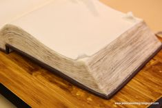 Open book cake tutorial. Also she talks about how to make a 'wood-grain' look on fondant.