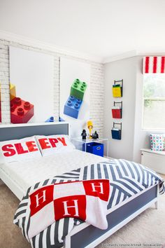 Kendra Wilkinson and Hank Baskett's modern big boy room for Hank Jr. Fun Lego wall panels. Designed by Vanessa Antonelli from NessaLee Baby