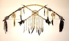 "this Large 42"" leather wrapped wood bow with its crossed arrows and three dreamcatchers makes a stunning wall display. Native American made $195.00 w. FREE SHIPPING within the USA #nativeamerican #dreamcatcher #artifact"