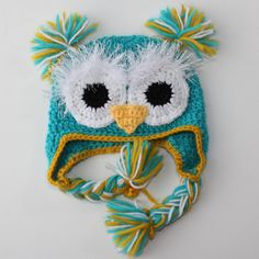Owl hat. I love the fuzzy eyes! This would be a great way to use  up some of the fuzzy yarns!