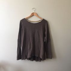 Free People Top Super comfy sweatshirt material Free People top. Very simple in the front with baby doll detailing in the back. The hem is intentionally frayed. Never worn and still have the tag! Free People Tops Tees - Long Sleeve