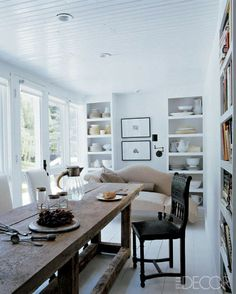 Daryl Carter designs after my own heart: white, ironstone, natural fabrics, and those awesome little black wall lamps