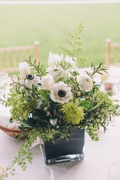 #anemone, #centerpiece  Photography: Anna Delores Photography - www.annadelores.com  Read More: http://www.stylemepretty.com/2014/08/20/elegant-modern-california-ranch-wedding/