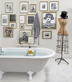 Don't be afraid to hang tons of art. | 27 Clever And Unconventional Bathroom Decorating Ideas