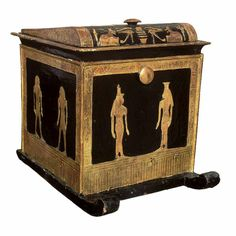 Wood with gold canopic box of Thuja.