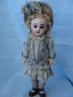 Teri's Antique Dolls is a great source for antique dolls and doll dresses...:)