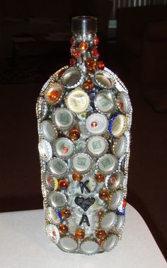 Personalized wine glass.....bottle caps and jewels....could be a candle holder, memory jar, or flower vase! Bottle Caps, Glass Bottle, Wine Glass, Glass Vase, Bottle Cap Projects, Wine Bottle Crafts, Pinterest Projects, Personalized Wine, Salad Bar
