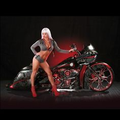 Photo shoot with our 2015 American Sniper tribute bike with the Karney Law Firm! #roadglide #2015 #harleydavidson #bagger #baggerporn #model #models #americansniper #chriskyle #army #camo #custompaint #performancemachine #dixon #26inchwheel #rakedbagger #hhi #topshop #moneymaker #carlbrouhard #vip #bobkarneylawfirm #bxcustomdesigns #thebikeexchange #calendergirls #7048248533