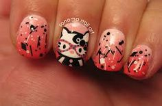hello kitty nerd nails.. My daughter would love this...