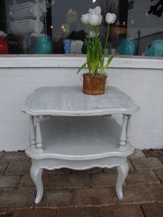 This French inspired side table has been painted in gray with a white glaze. The top has a faux bois treatment.