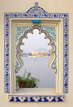 Great inspiration for a picture frame with white and blue patterns! Love the inner shapes of that window, and the turquoise and blue on white.
