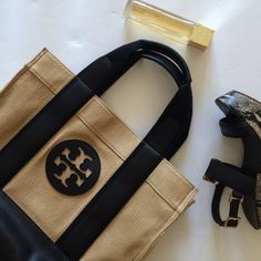 Weekend Sale‼️Adorable Canvas Tory Burch Tote In like new condition with very minimal wear to bottom of bag this canvas Tory tote is perfect for spring and summer! Lots of room inside with pockets. 100% authentic. Dimensions are approximately 16 inches wide and 13 inches tall Tory Burch Bags Totes