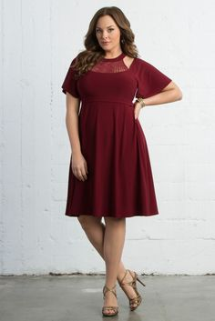 Dress up your night in our plus size Elise Flutter Dress. A gorgeous silhouette and metallic mock neck stand on their own with little accessorizing. Shop our entire made in the USA collection and see more style inspiration online at www.kiyonna.com.