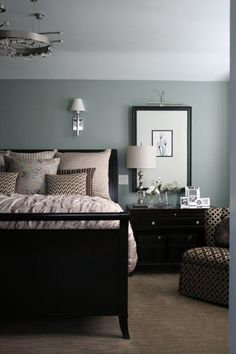this master bedroom is decorated painted a tranquil grey for a soothing atmosphere