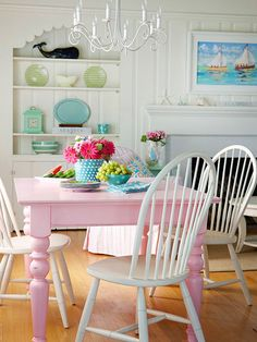 Move farm table to playroom and paint a fun color?  Maybe something more gender-neutral than this pink, but this is so cute for kids.  Mix and Chic: Cottage style decorating ideas!