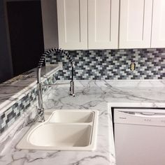 Beautiful new kitchen redesign and renovation from @sarahestroup featuring Formica® 180fx® laminate Calacatta Marble.  ---------- The backsplash looks amazing! Can't wait to see it with the grout! Thanks @candybu_12 😍😍😍 #backsplash #formica @formicagroup #calacuttamarble #industrialglam #mosaictile #glassmosaic #kitchenreno