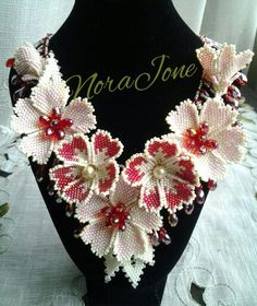 A netted necklace with red hot flowers...