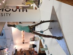 A fantastic sculpture made from glass and found branches by Presiana Shisheva, Falmouth University stand CAA34