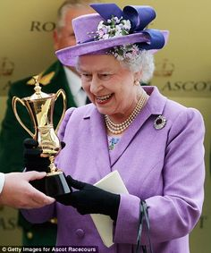 Ascot Day 3, 2013....The Duke of York presents his mother with a trophy after her horse Estimate won the Gold Cup during day three of the Royal Ascot, and the Queen cannot hide her delight