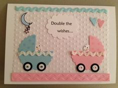 "Baby Shower card for boy/girl twins. Inside says, ""for twice the fun"" and is stamped with two rubber ducks - one pink and one blue."
