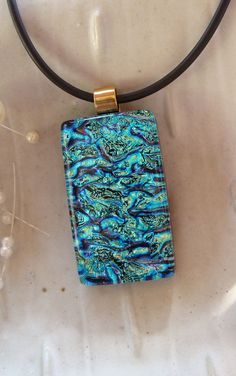"From Etsy's ""myfusedglass"" Dichroic Fused Glass Pendant, Necklace, Glass Jewelry, Aqua, Cobalt Blue, Gold, Necklace Included. $24.00, via Etsy."