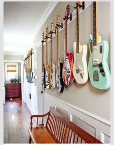 Lovely bench, guitars on wall, wall colors, wainscoting