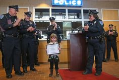 March 12 / Weymouth -- This 3-year-old girl, Aryanna Lynch, had saved her pregnant mother's life by calling a cousin for help when she had a seizure. They had her come to the Weymouth Police Station, and they gave her some toys, stuffed animals, and a plaque saying how good she was. They gave her a round of applause as she stood there.