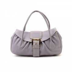 69603669be48 LXRandCo guarantees the authenticity of this vintage Céline handbag.  Crafted in leather