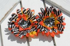 Check out this item in my Etsy shop https://www.etsy.com/listing/116627817/mini-orange-zebra-spring-daisy-piggytail