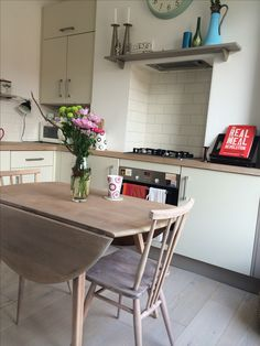 Ercol sanded and white oiled drop leaf round dining / kitchen table with all purpose chair