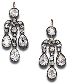 A PAIR OF DELICATE ANTIQUE DIAMOND EAR-PENDANTS. Of girandole design, set with three pear-shaped diamonds to the scrolled surmount suspended from a collet top, circa 1860, in brown leather fitted case.