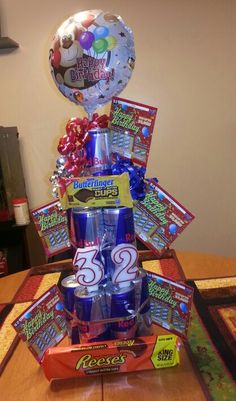 A Red Bull Cake With Candy And Lottery Ticket For My Husbands Birthday Basket