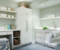 Glossy green subway, ikea cabinetry, rolling press for sheets | 2010 Princess Margaret Showhome | House & Home