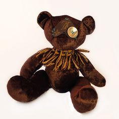 """Kafi by Tara Logsdon (""""Meet Kafi. Tara Logsdon of EKL bearmy rescued this sweet teddy bear, who was in grave need of physical and psychological repair, from a thrift store. After many long hours in the OR spent repairing dismembered appendages using hand-stitching techniques, the patient was given a new heart (to ease abandonment issues) and new eyes (for a new outlook on life). Now its mission in life is to combat mass production and consumption."""")"""