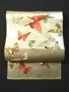 A gold obi decorated with embroidered butterflies. Ichiroya.com