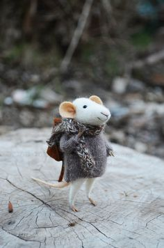 This little mouse is Its made with the softest merino wool. He Holds standing alone just have to adjust the foot and tail properly.
