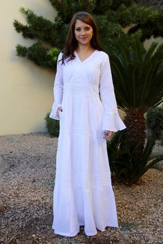 f44db1a05085 Cotton embroidered white temple dress. V-neckline, full length bell  sleeves, tiered