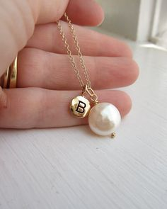 I love this. Elegant and personal. Stop in a month before your wedding and we can engrave any piece of jewelry. We can also get loose colored pearls from Honora and make this completely personal for each brides maid.