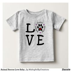 """Animal Rescue Love Baby Fine Jersey T-Shirt This baby fine jersey t-shirt shows your love for animals and animal rescue. The word """"love"""" is spelled with the letter O represented by a paw print with a red heart inside surrounded by the words adopt, foster and rescue separated with purple paw prints. This is a great gift for yourself or a baby shower gift for any animal lover. This could also be used by animal shelters as a raffle item or in a silent auction fundraiser."""