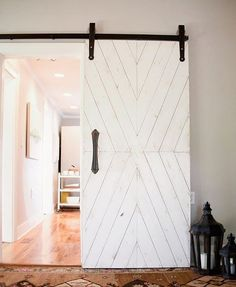 Chevron sliding barn door with vintage inspired hardware