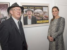 Catherine, Duchess of Cambridge poses for photo with Ron Scott next to a poster of him during her visit to Resort Studios in Cliftonville on March 11, 2015 in Margate, England.